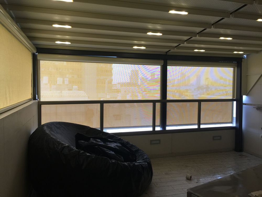 דוגמא לסגירת חורף למרפסת - תל אביב